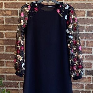 Black dress with embroidered sleeves